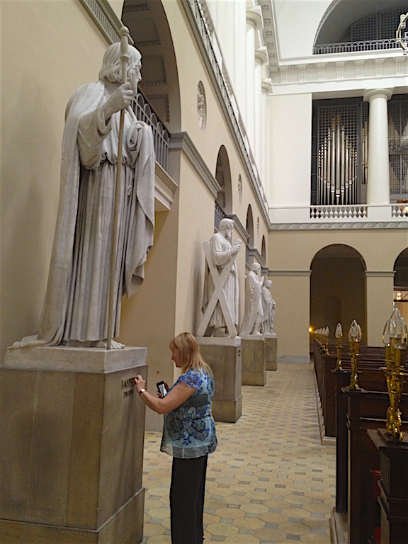Elaine touching a statue in a Copenhagen Denmark church