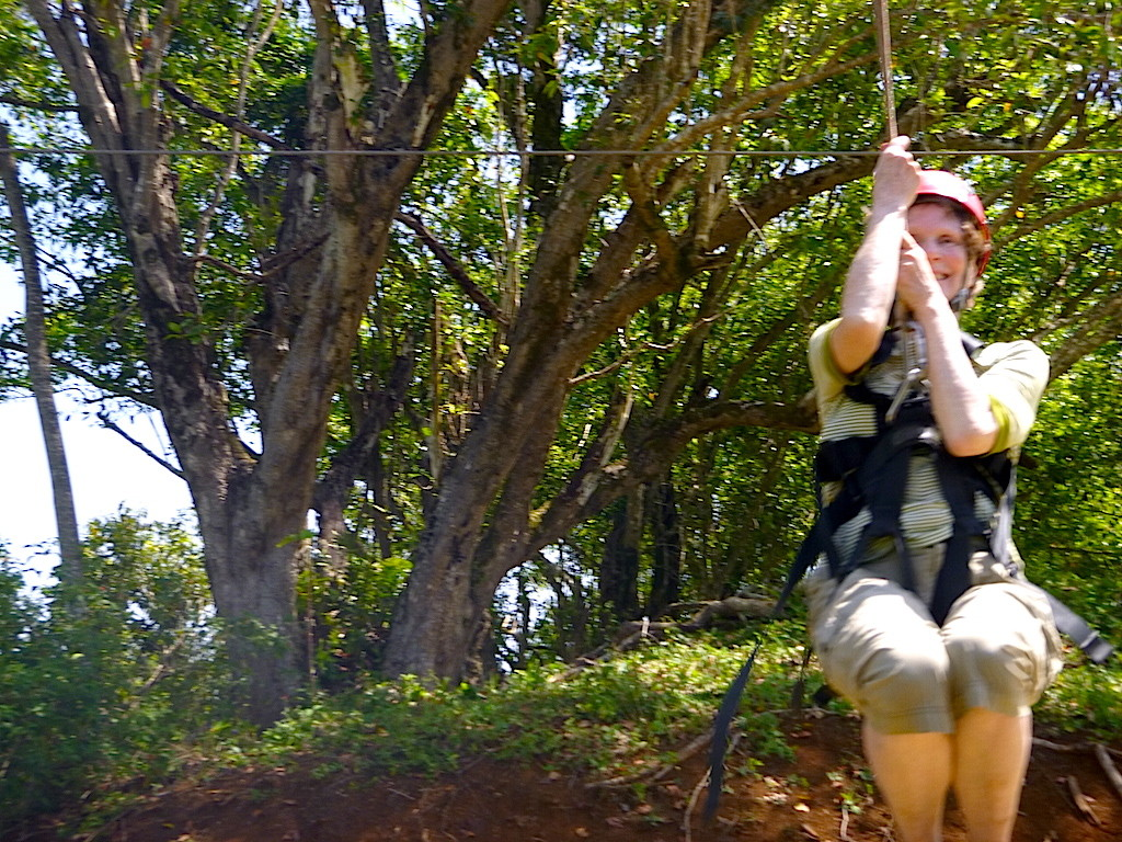 Terrianne zip lines over a Hawaiian rain forest