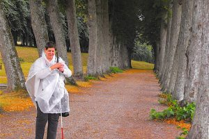 One of Dave's friends standing on a tree lined path in Denmark