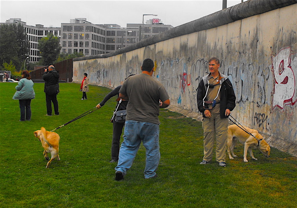Glen & Donna with their guide dogs at the Berlin Wall