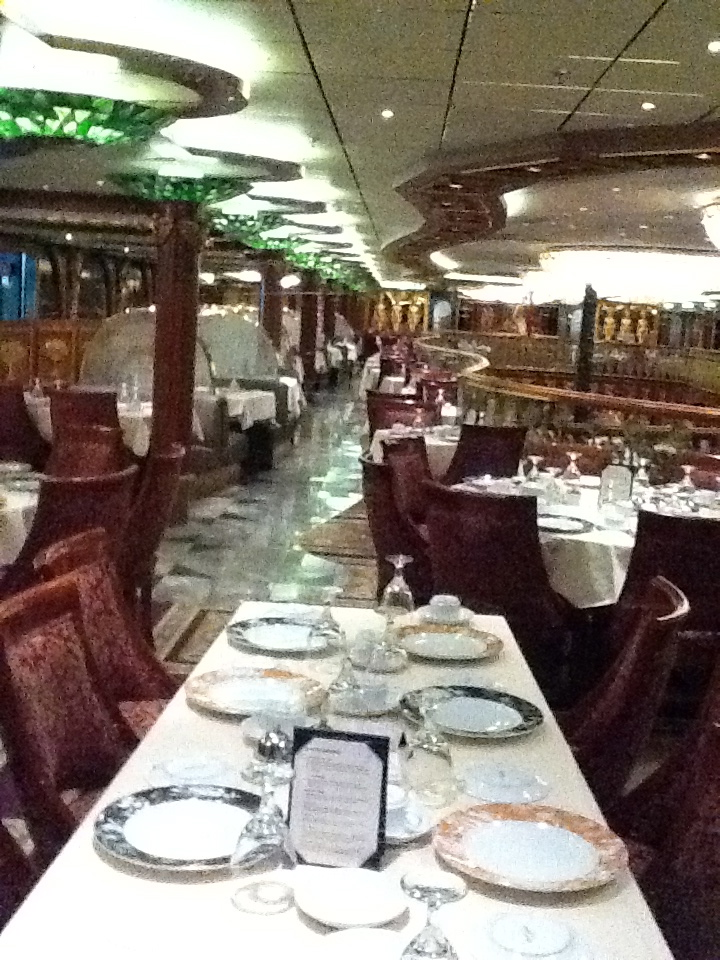 In the Carnival Spirit's main dining room a table is set with fine china