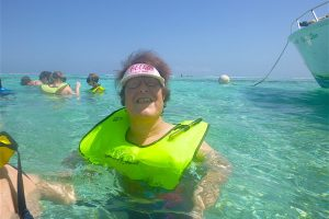 Mary Susan swimming with stingrays off the coast of Belize
