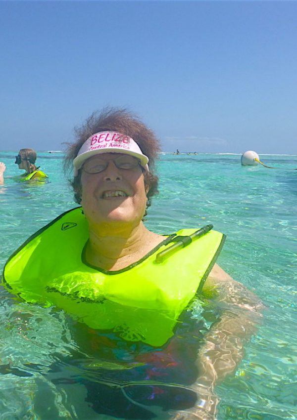 Mary swimming with stingrays in Belize